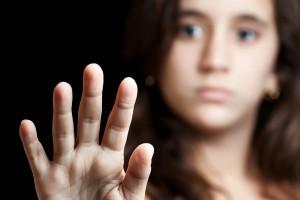 Hispanic girl signaling to stop